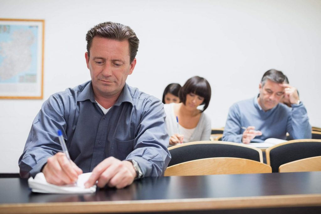 Adult driving school student sitting in a classroom